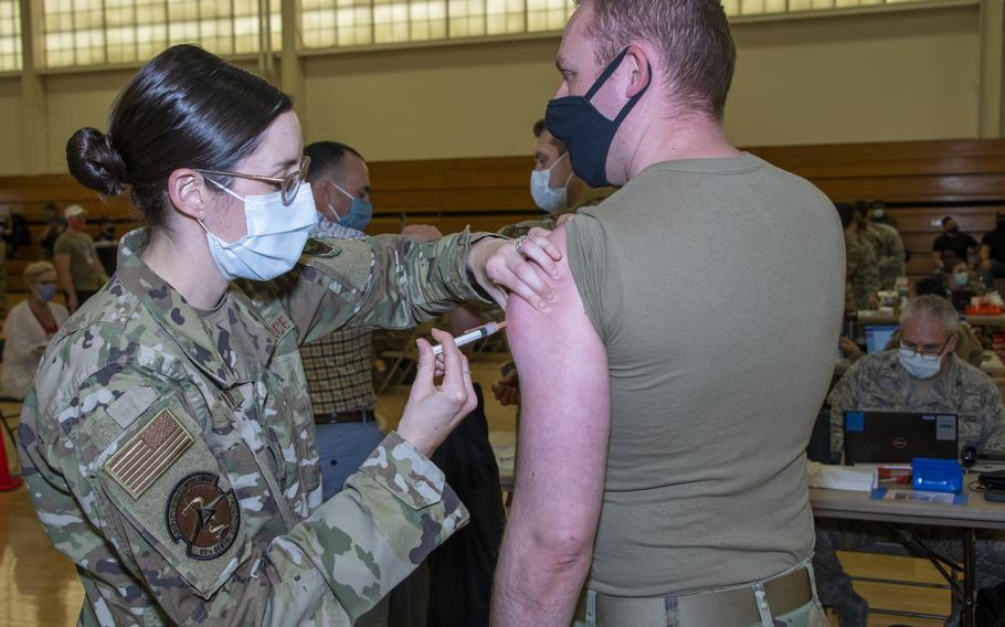 U.S. Air Force Maj. Sarah Ringdahl, 60th Dental Squadron periodontist, administers a COVID-19 vaccine to Capt. Marshall Neubauer, USAF Reserve Officers' Training Corps Assistant Professor of Aerospace Studies, Jan. 8, 2021 at Travis Air Force Base, Calif. The Air Force has set a Nov. 2 deadline for active-duty airmen and guardians to be fully vaccinated against the coronavirus, and Dec. 2 for reservists and Guardsmen, unless they have a valid exemption.