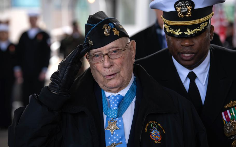 """Medal of Honor recipient Hershel Woodrow Williams salutes as he is introduced at the USS Hershel """"Woody"""" Williams commissioning ceremony, March 7, 2020, in Norfolk, Va."""