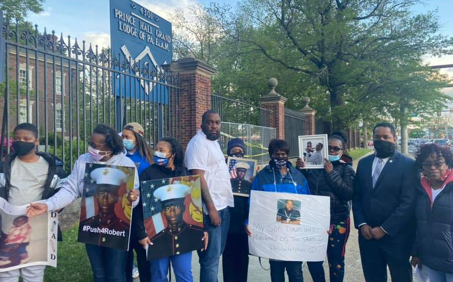 Oronde McClain, fourth from left, was shot in the head when he was 10. Now 31, he works as a psych tech at the Philadelphia VA Medical Center.