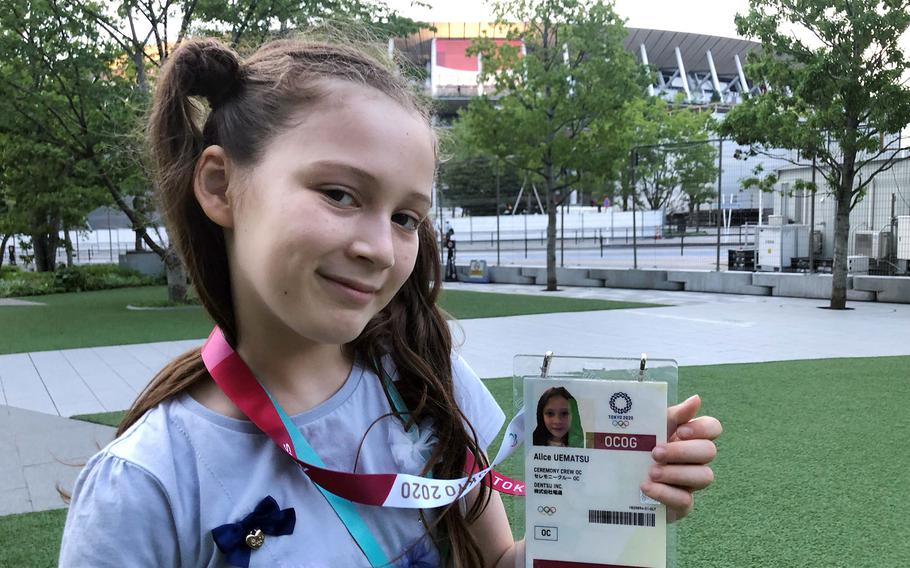 Alice Stratton, daughter of Master Sgt. Joseph Stratton, inspector general superintendent for the 374th Airlift Wing at Yokota Air Base, poses outside the Olympic stadium ahead of the opening ceremony on July 23, 2021.