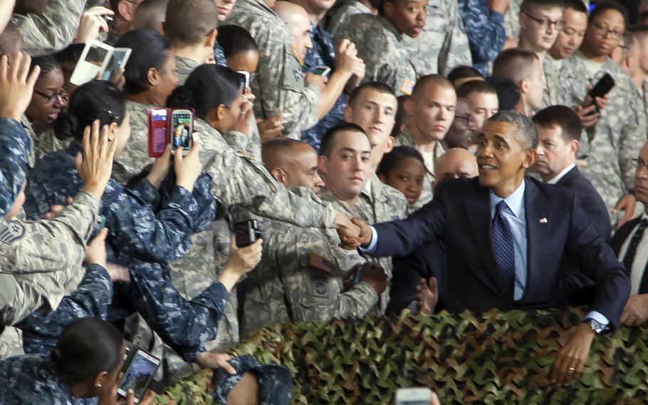 Then-President Barack Obama shakes a service member's hand following a speech at Yongsan Garrison in Seoul, South Korea, April 26, 2014.