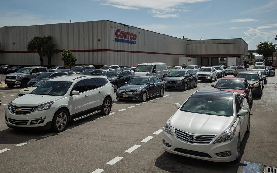 Drivers queue at a Costco in Lantana, Fla., on May 12, 2021., following a ransomware attack on US east coast gasoline supplier Colonial Pipeline that caused supply shortages in multiple states.