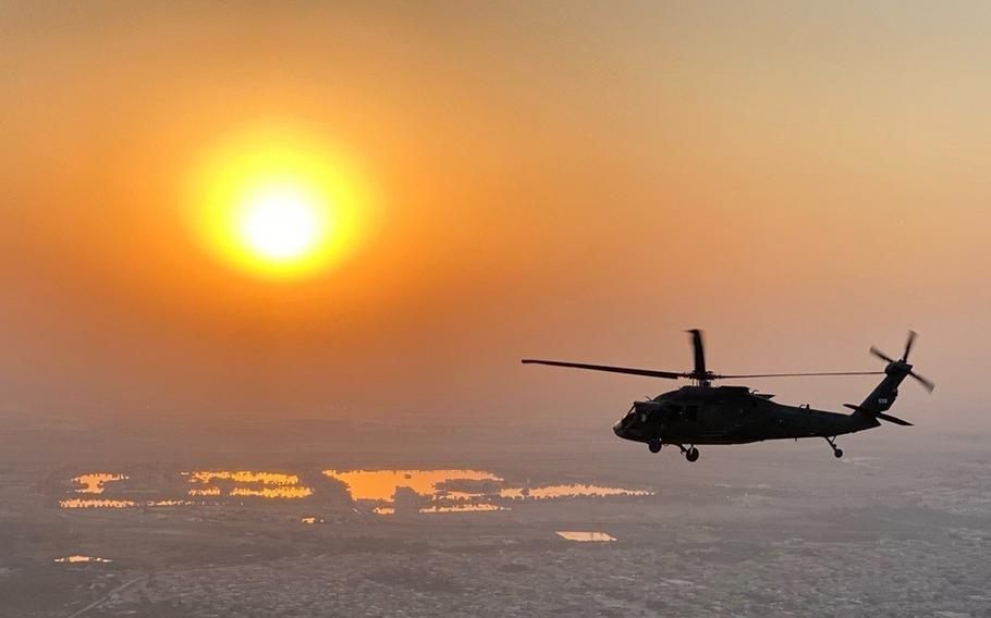 A U.S. Army UH-60 Black Hawk helicopter flies over Iraq in 2020. In a move that could help the Army retain pilots, the service is making it easier for retired warrant officers to serve in the Reserve and Guard, the Army said in a statement July 13, 2021.