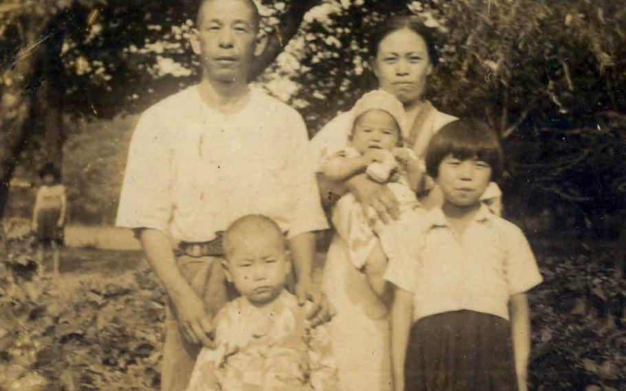 This portrait of a couple with three young children was among photographs recovered by a fallen Marine from a Pacific battlefield during World War II.
