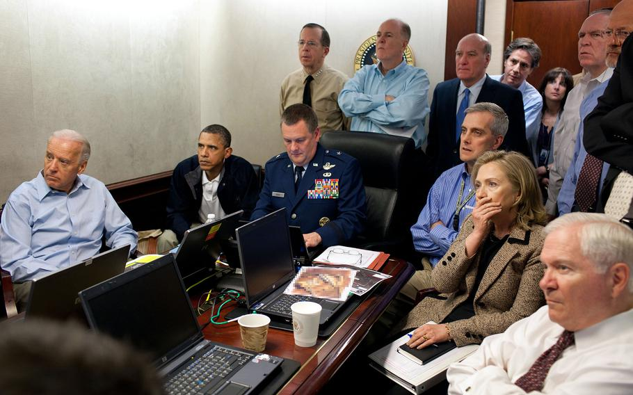 In this handout image provided by The White House, President Barack Obama, Vice President Joe Biden, Secretary of State Hillary Clinton and members of the national security team are said to receive an update on the mission against Osama bin Laden in the Situation Room of the White House on May 1, 2011, in Washington, D.C. (A classified document visible in this photo was obscured by The White House.