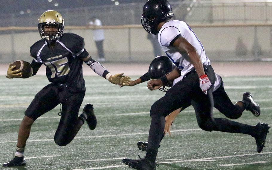 Humphreys Gold's Darryl Veal tries to elude Osan's Jaylon Grant.