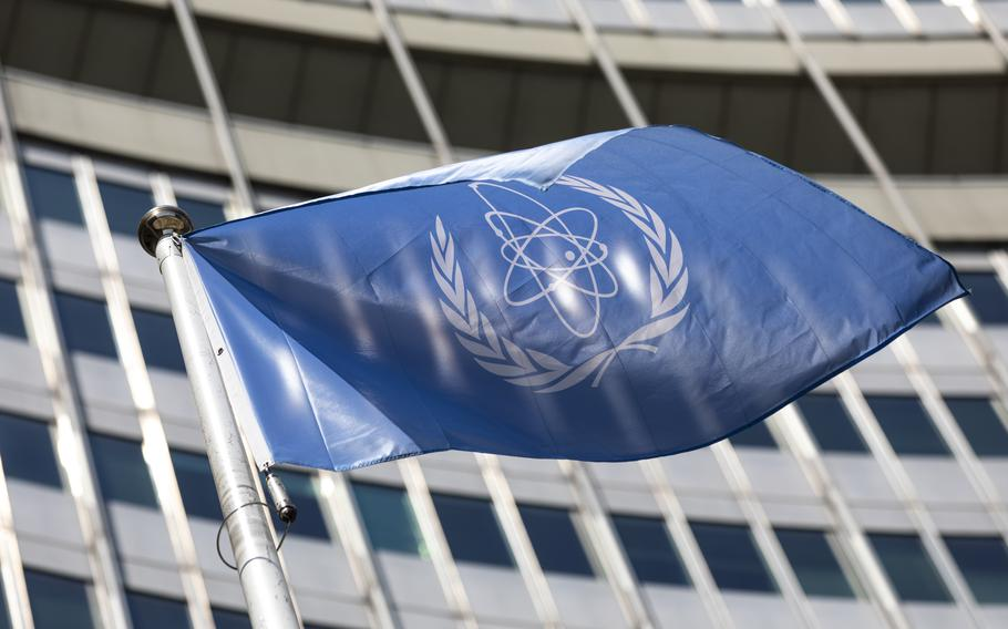 The flag of the International Atomic Energy Agency (IAEA) waves at the entrance of the Vienna International Center in Vienna in June 2021.