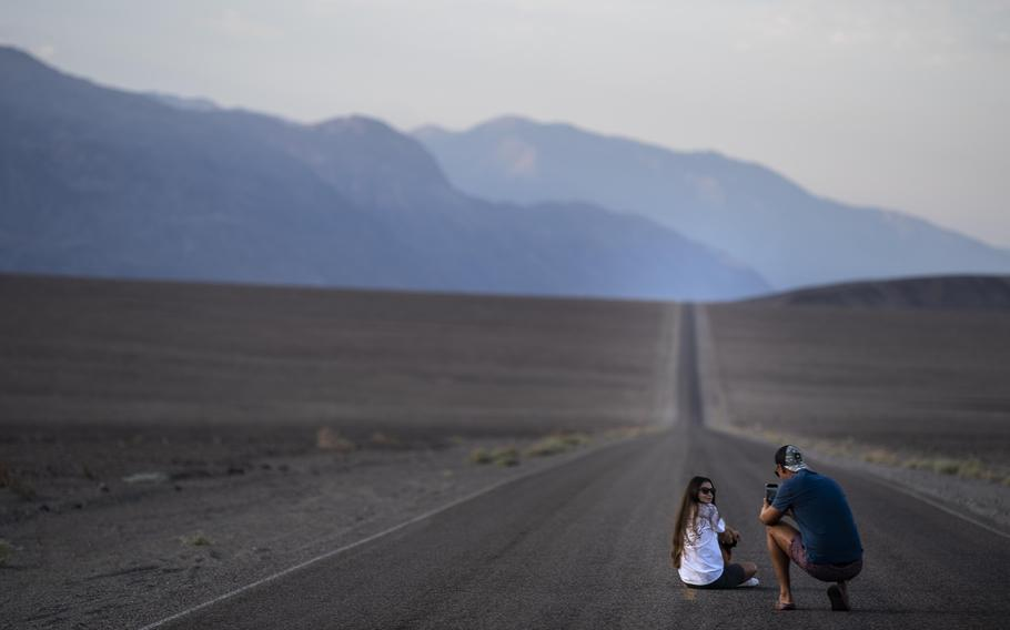 Tourists from Moldova stop to take pictures along Badwater Road early Saturday.