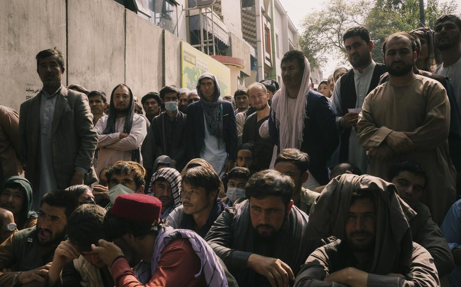 Holders of bank accounts wait in front of a Kabul bank on Sept. 29, 2021.