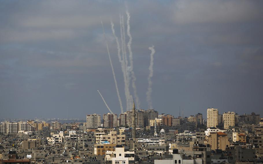 In this May 20, 2021 file photo, rockets are launched from the Gaza Strip towards Israel, in Gaza City.