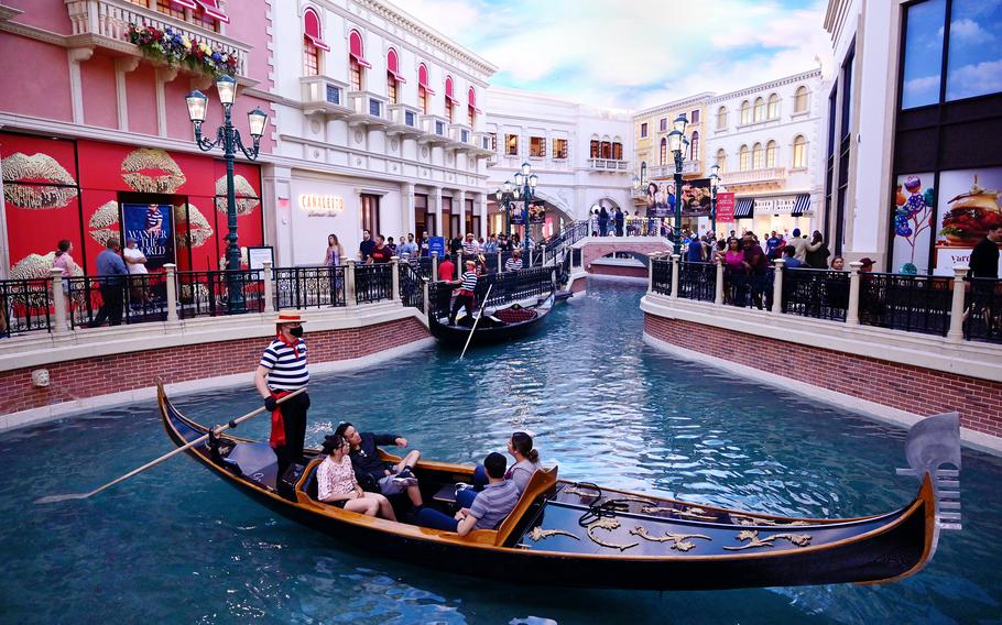 Tourists glide down the Grand Canal in a gondola at the Venetian Resort.