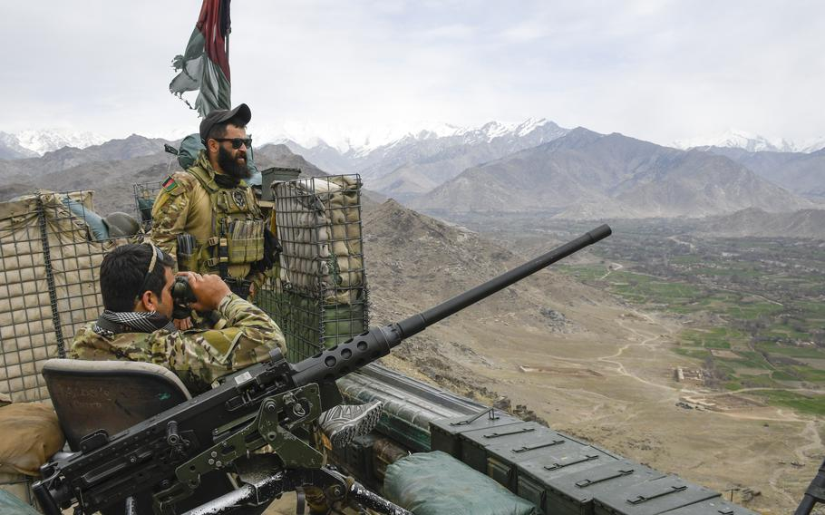 Maj. Sohrab Azimi, a decorated Afghan special forces officer, looks over a valley in the northeastern province of Kapisa, Afghanistan, in March 6, 2021. Azimi was killed fighting the Taliban in Faryab province on June 16, 2021.