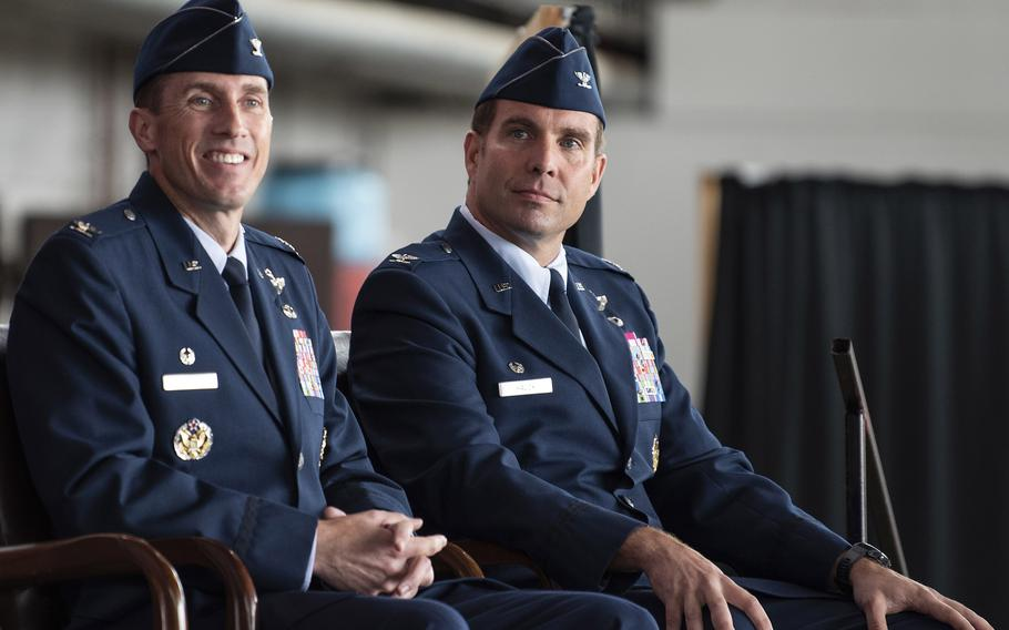 Col. David Epperson, left, the 52nd Fighter Wing's outgoing commander, and Col. Leslie Hauck, the incoming commander, listened to opening remarks from Maj. Gen. Randall Reed, 3rd Air Force commander, during the wing's change of command ceremony July 15, 2021, on Spangdahlem Air Base, Germany.