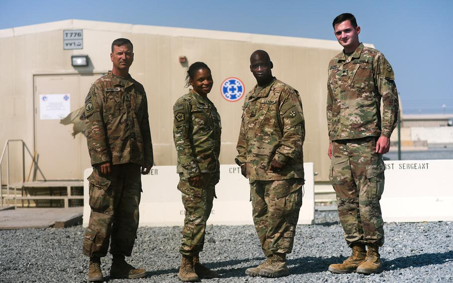 Master Sgt. Lloyd Cossey, Staff Sgt. Steve Augusten, Sgt. Nicole Hall and Spc. Patrick H. Watrous with the Army Reserve's Indianapolis-based 310th Sustainment Command (Expeditionary) returned to Camp Arifjan, Kuwait recently, after providing support to service members at Afghanistan's Bagram Airfield, as the U.S. base closed.