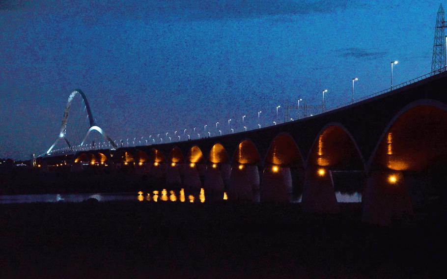 The Oversteek Bridge in Nijmegen, the Netherlands, is fully illuminated after nightfall on Aug. 13, 2021.