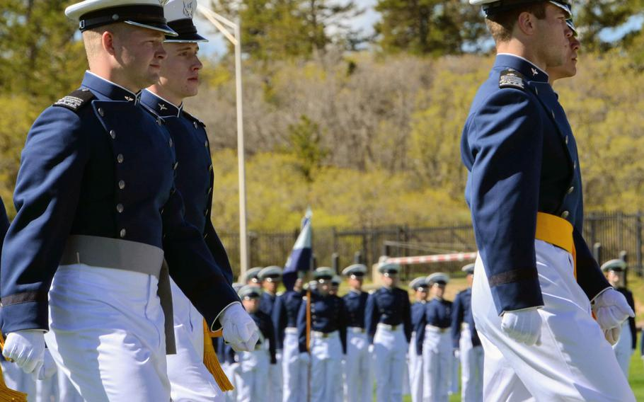 Air Force Academy Cadet 1st Class Tanner Johnson, left, marches with Cadet Squadron 14 in the graduation parade at the Colorado Springs, Colo., service academy, May 25, 2021. Johnson was commissioned that day into the U.S. Space Force, becoming the first person diagnosed with Type 1 diabetes to be allowed to serve in the U.S. military.
