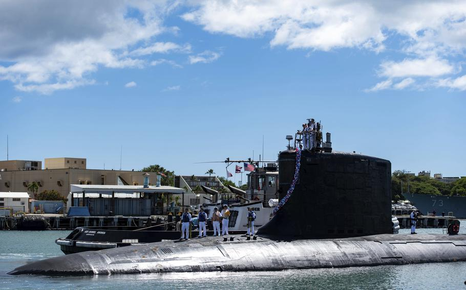 In this photo provided by U.S. Navy, the Virginia-class fast-attack submarine USS Illinois returns to Joint Base Pearl Harbor-Hickam from a deployment in the 7th Fleet area of responsibility on Sept. 13, 2021.