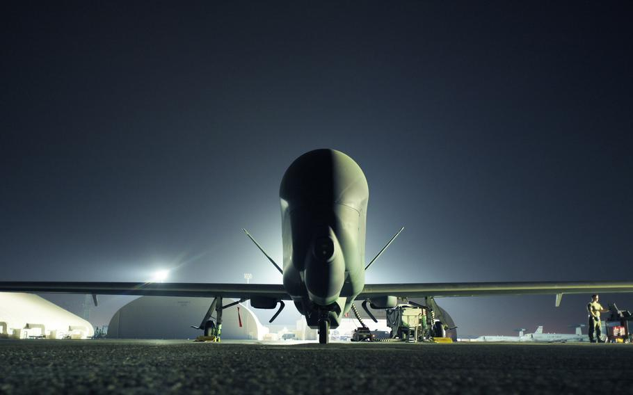 An RQ-4 Global Hawk assigned to the 99th Expeditionary Reconnaissance Squadron sits on the flight line at Al Dhafra Air Base, United Arab Emirates, May 7, 2021.