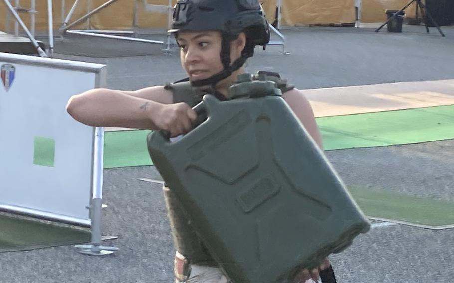 Sgt. Patricia Martinez hefts one of five full, 40-plus pound jerrycans as part of Fort Eustis' battle challenge competition on May 24, 2021.
