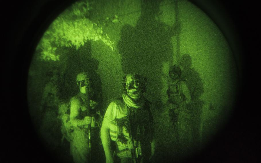 An elite special forces unit conducts a clearing operation in an area under Taliban control in Kunduz, Afghanistan, in July 2021.