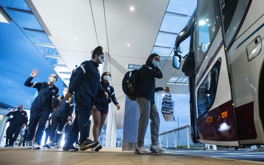 Members of the U.S. women's Olympic fencing team load onto a bus heading to Marine Corps Air Station Iwakuni, Japan, Tuesday, July 13, 2021.