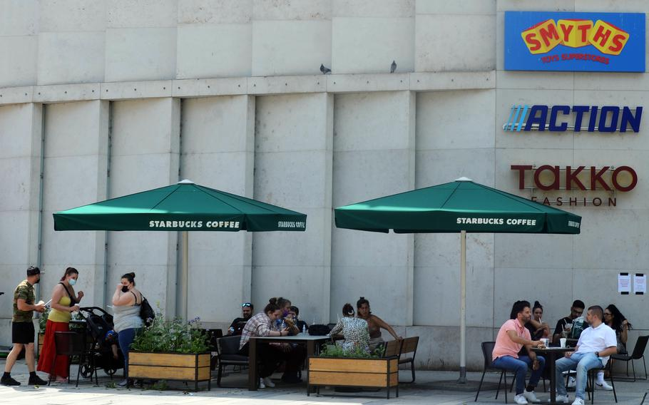 The outside seating at a Starbucks in Wiesbaden, Germany, is packed on June 10, 2021. Coronavirus restrictions on shopping, indoor dining, sporting events and other facets of daily life continue to ease in the city, which is home to U.S. Army Europe and Africa headquarters.   David Edge/Stars and Stripes