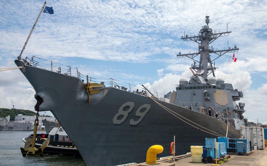 The guided-missile destroyer USS Mustin prepares to depart Yokosuka Naval Base, Japan, June 22, 2021.