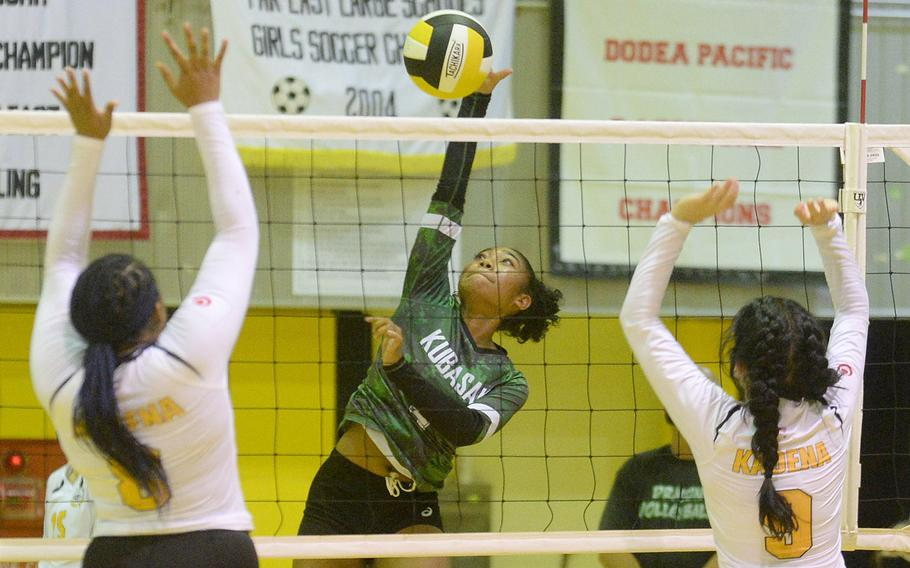 Kubasaki's Risha McGriff spikes against the double block of Kadena's Kyleigh Wright and Joan Buysman during Thursday's Okinawa volleyball match. The Dragons won in straight sets to improve to 4-0 in the season series.
