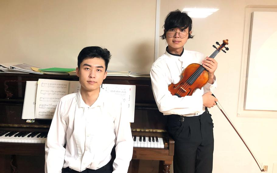 Brothers David Lee, right, a high school senior at Osan Air Base, South Korea, and Ralph Lee, an Osan graduate, founded Music Echoes to produce free music for hospital and nursing home patients during the pandemic.