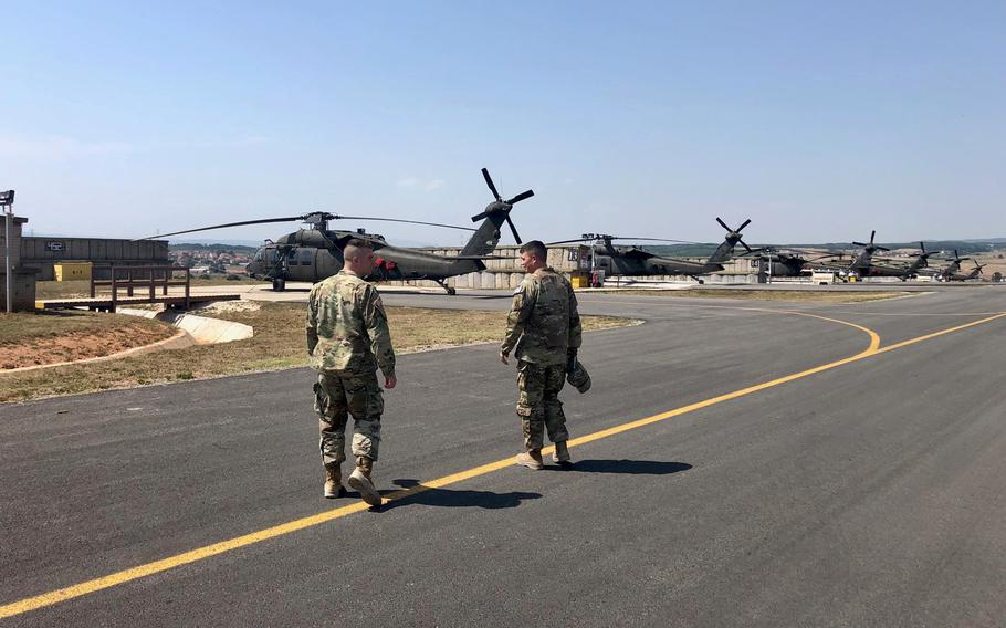 Two members of the Vermont Army National Guard walk down the flight line at Camp Bondsteel in Kosovo. The Vermont battalion deployed to in July for a rotation lasting at least nine months.