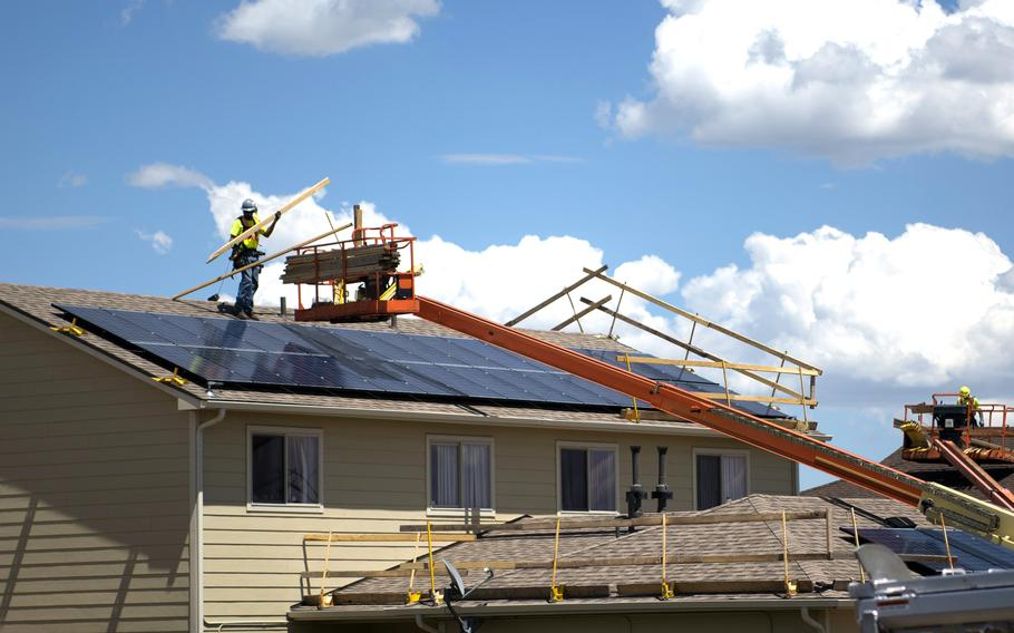 Construction workers replace the shingles on roofs at Tierra Vista Communities at Schriever Air Force Base, Colo., July 8, 2019.