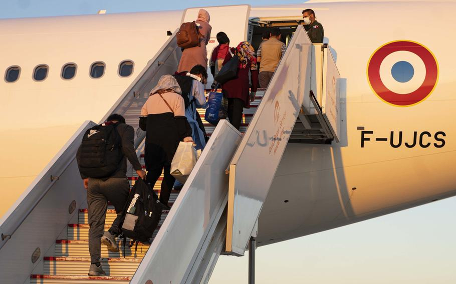 Evacuees from Afghanistan board a flight on Sept. 2, 2021, to the United States at Naval Station Rota in Spain. The Rota base is supporting the Department of State mission to facilitate the safe relocation of U.S. citizens, Afghans seeking special immigration visas, and other vulnerable Afghans.