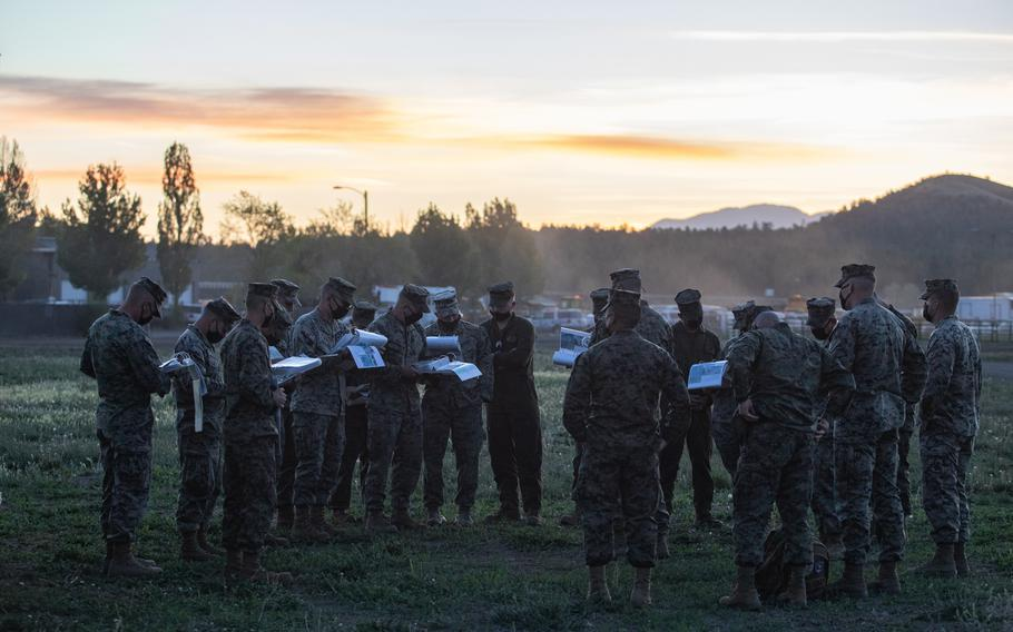 Marines conduct a briefing before departing Williams, Ariz., May 15, 2021. Marines in tactical vehicles and trucks drove from Camp Lejeune, N.C., to Twentynine Palms, Calif., in one of the longest convoys in the service's history.