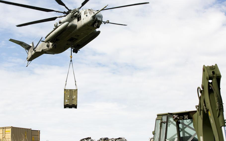 A CH-53E Super Stallion from Marine Heavy Helicopter Squadron 462 airlifts equipment for the Poseidon's Watchtower exercise on Irisuna Island, Okinawa, June 3, 2021.