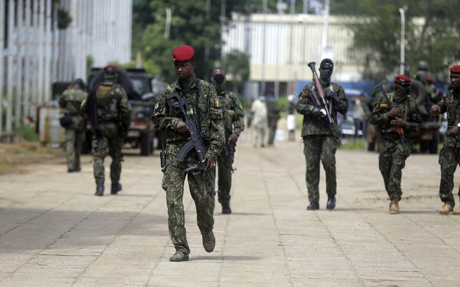 Guinean soldiers patrol outside the Presidential palace in Conakry, Guinea Friday, Sept. 10, 2021.