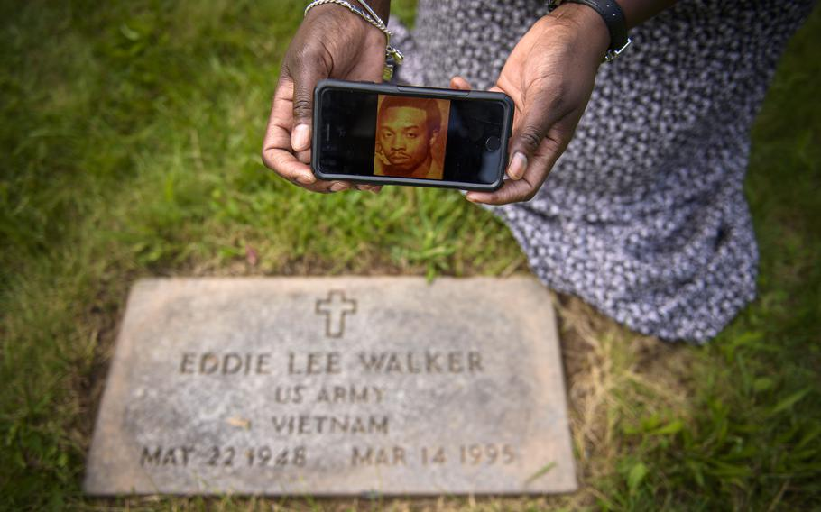 Windsor resident Sonia Turner displays a photograph of her father, Eddie Lee Walker, a Vietnam War veteran. Turner said grass was covering her father's headstone but was cleared when she complained to Hartford officials about the neglect of her father's gravesite. But while the stone of her father, a Vietnam veteran, had been raised and the grass cut away, other stones over other veterans' graves remain neglected. Turner says she won't stop pressing the issue until all the grave sites at the Hartford-maintained cemetery are treated with the dignity they deserve.