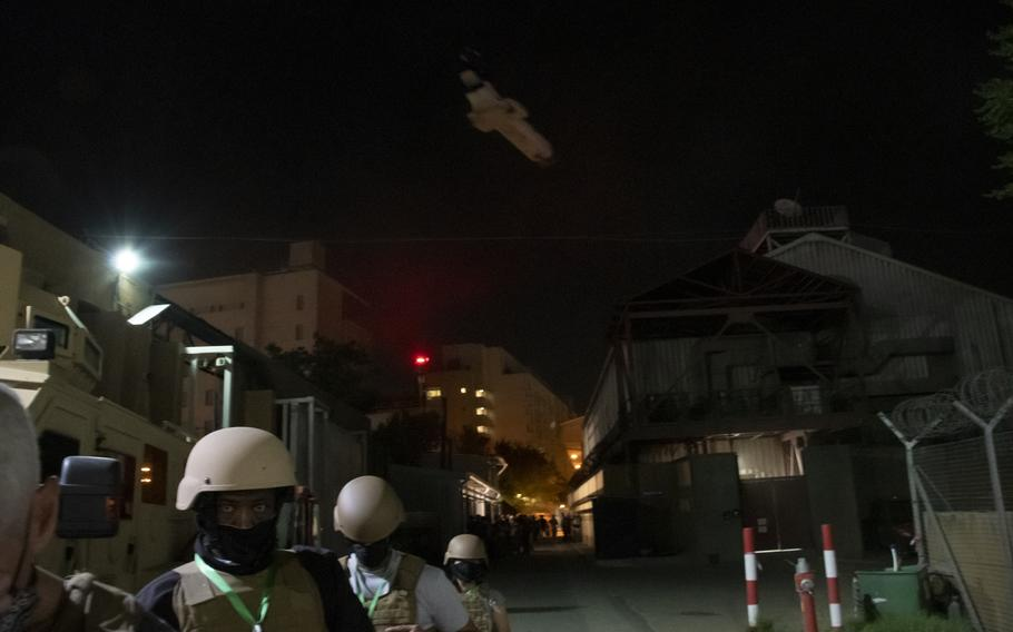 Staff evacuate the U.S. Embassy in Kabul shortly after midnight on Sunday, Aug. 15, 2021. Hundreds of people traveled by helicopter from the embassy to the city's airport overnight. The insurgents entered Kabul's outer suburbs later Sunday.
