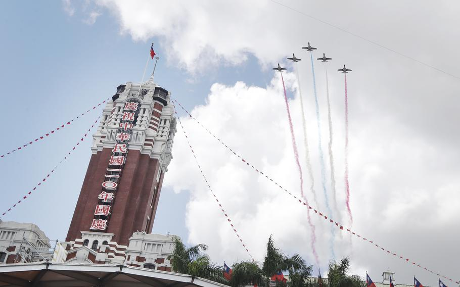 Thunder Tiger Aerobatics Team fly over President Office during National Day celebrations in Taipei, Taiwan, Sunday, Oct. 10, 2021.