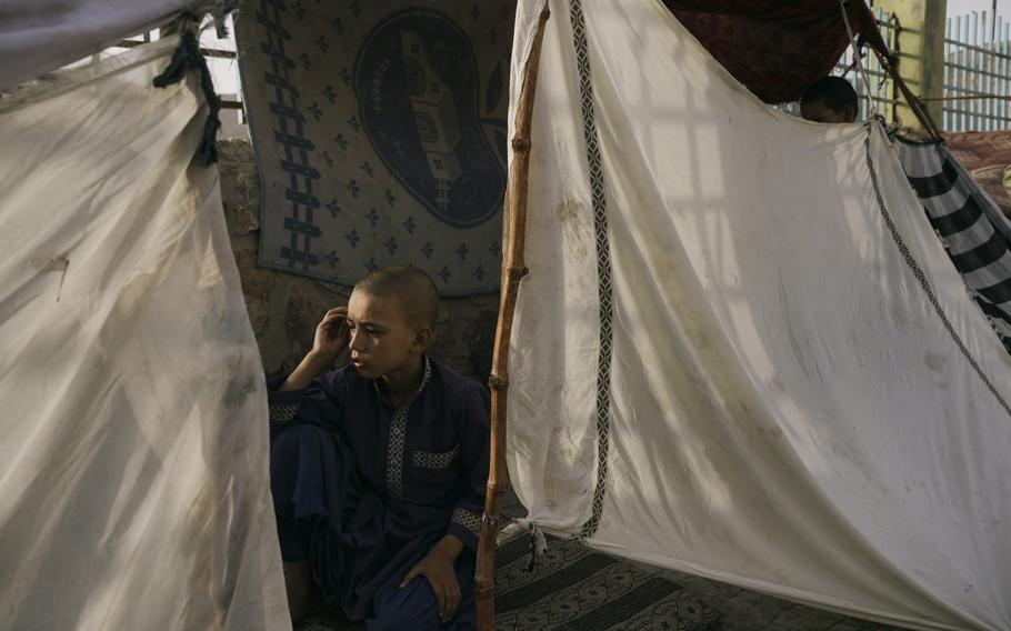 A boy rests in a shelter in Kandahar on July 30, 2021.