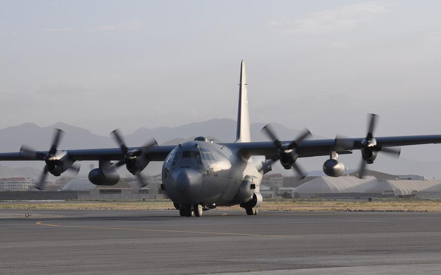 A C-130 Hercules touches down at Hamid Karzai International Airport, Kabul, June 20, 2015. The Pentagon announced on Thursday, Aug. 12, 2021, that three infantry battalions would be deployed to the airport to help evacuate U.S. diplomats.