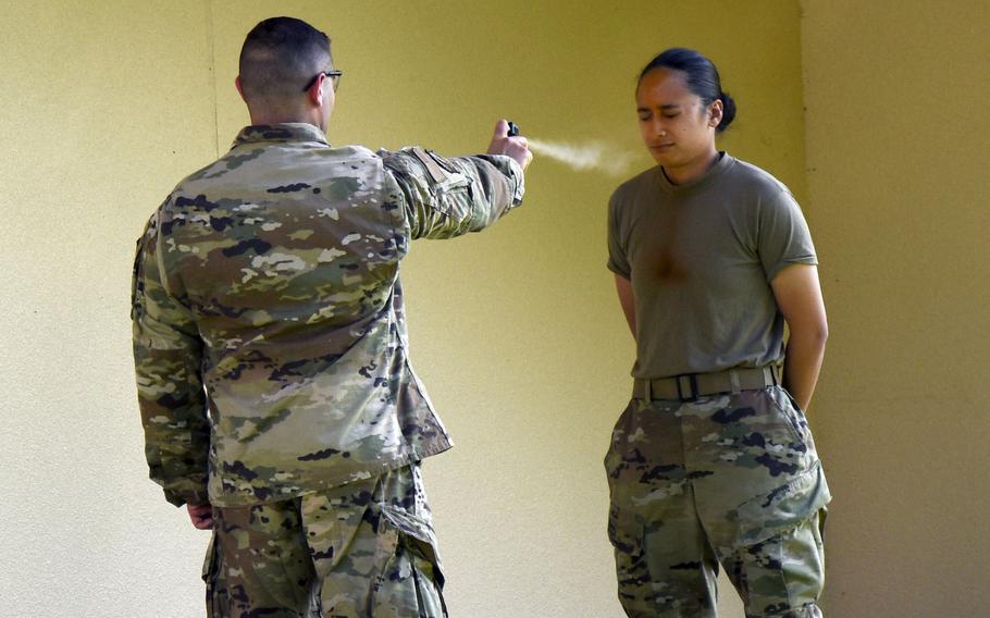 Airman 1st Class Taylor Arias is pepper-sprayed during training at Yokota Air Base, Japan, July 21, 2021.