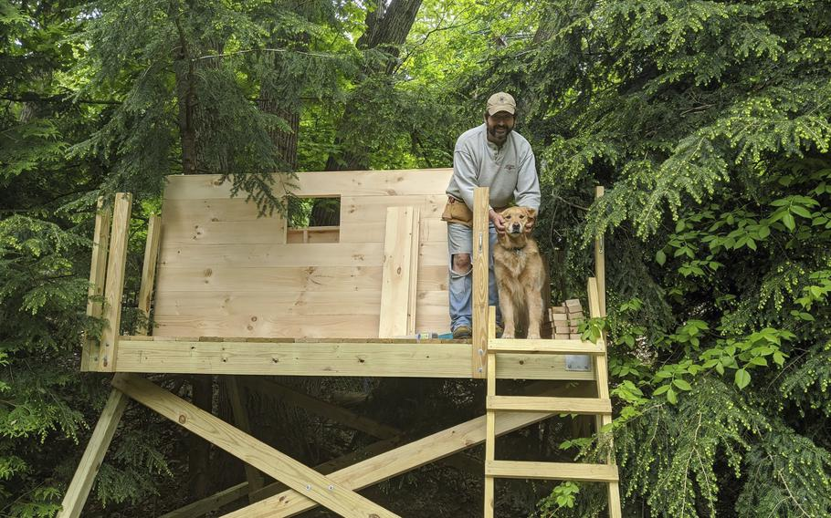 This photo taken by Nanci Butler in 2020 shows her husband, Ethan, in the backyard treehouse they built during the Covid-19 pandemic lockdown. About three months after it was built, an oak tree fell on top of the treehouse and demolished it.
