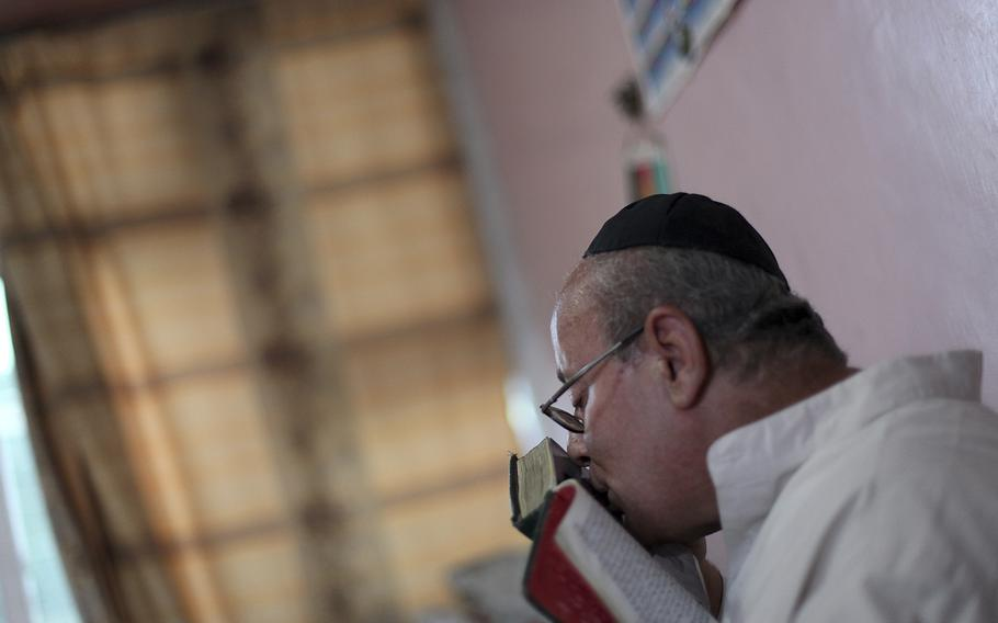 Zebulon Simentov, the last known Jew living in Afghanistan and the caretaker and sole member of Afghanistan's only working synagogue kisses his prayer book while observing Shabbat in his Kabul home onAug. 29, 2009. Simentov who prayed in Hebrew, endured decades of war as the country's centuries-old Jewish community rapidly dwindled has left the country.