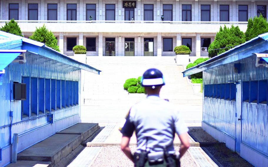 North and South Korean soldiers stand guard in May 2017 at the Joint Security Area of the Demilitarized Zone, which divides the two Koreas.