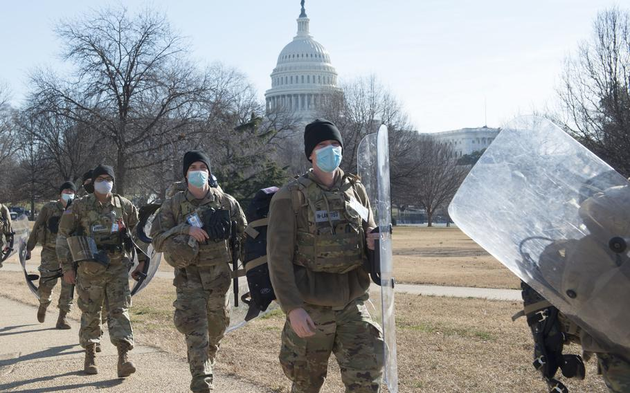 Soldiers with Delta Company, 1st Battalion, 293rd Infantry Regiment of the Indiana National Guard provide security near the Capitol on Jan. 21 in Washington.