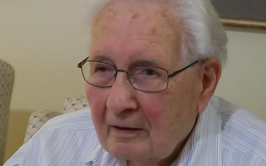 A video screen grab shows Holocaust survivor Irving Bienstock talking about his experience surviving Nazi Germany during WWII
