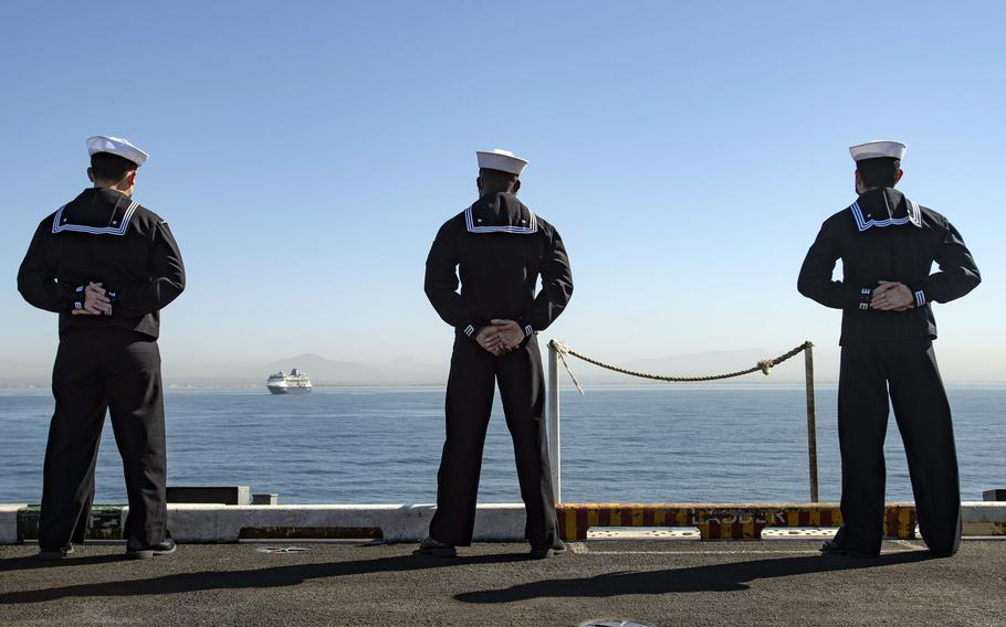 Sailors man the rails on the flight deck of the aircraft carrier USS Nimitz in San Diego, Feb. 26, 2021.