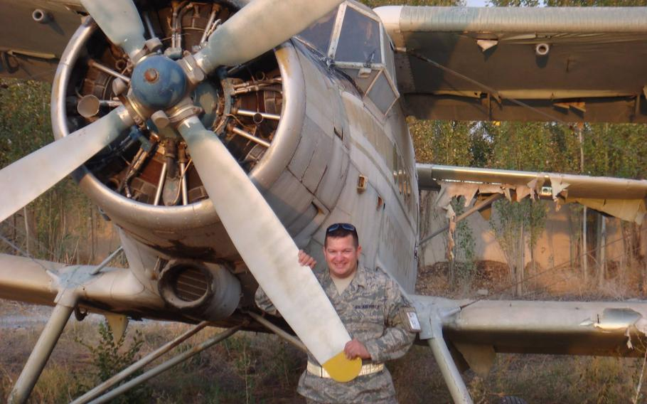 Then-Air Force Tech Sgt. Gino Lucci stands by a prop plane at Manas Air Base in Kyrgyzstan in 2010. Lucci, who deployed around the world during his 25 years in the service, retired in 2015. Four years later, he turned a World War II-era plane into a roadworthy motor home.