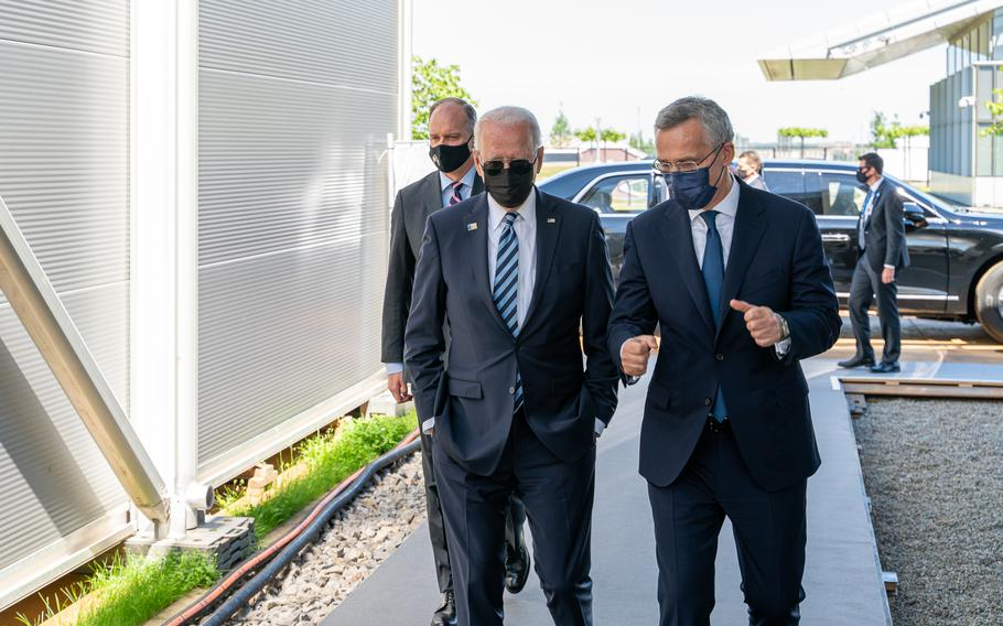 President Joe Biden arrives at NATO Headquarters escorted by Secretary-General Jens Stoltenberg in Brussels, Belguim, June 14, 2021.
