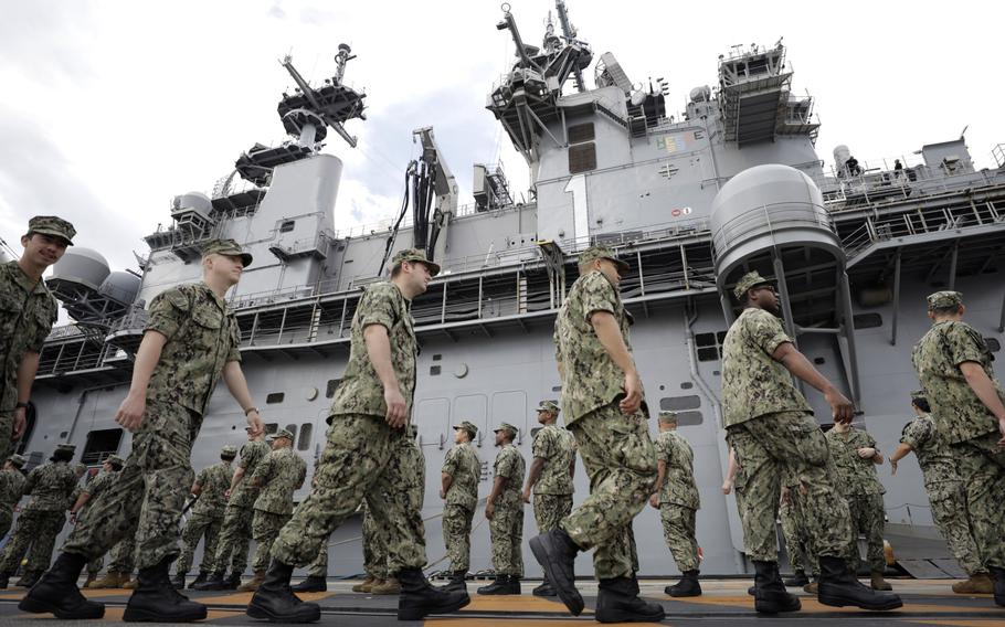 U.S. military personnel gather to board the USS Wasp aircraft carrier ahead of the Memorial Day address by President Trump at the U.S. naval base in Yokosuka, Kanagawa Prefecture, Japan, on May 28, 2019.